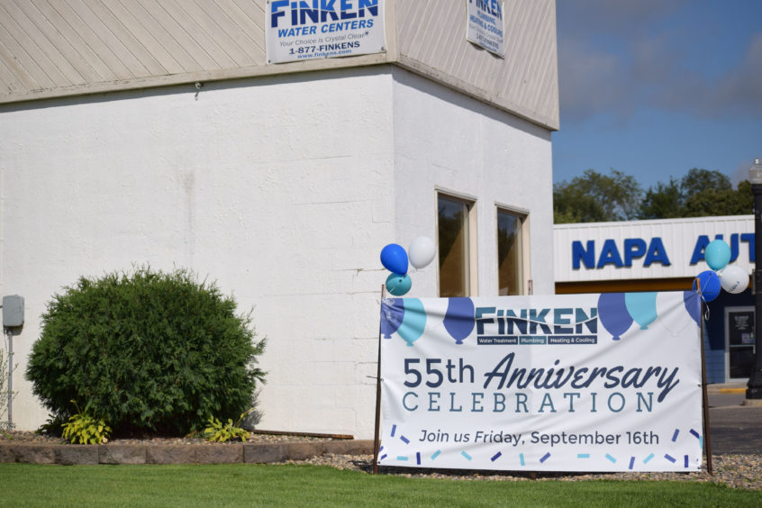 A sign denotes the 55th anniversary celebration held at the Melrose location.